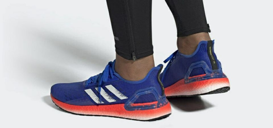 person wearing blue and orange running shoes