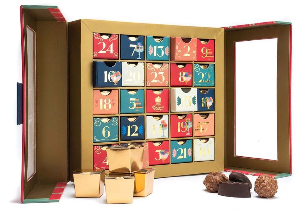 advent calendar with numbered boxes with gold and chocolate