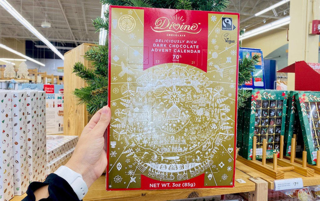 hand holding gold advent calendar in store