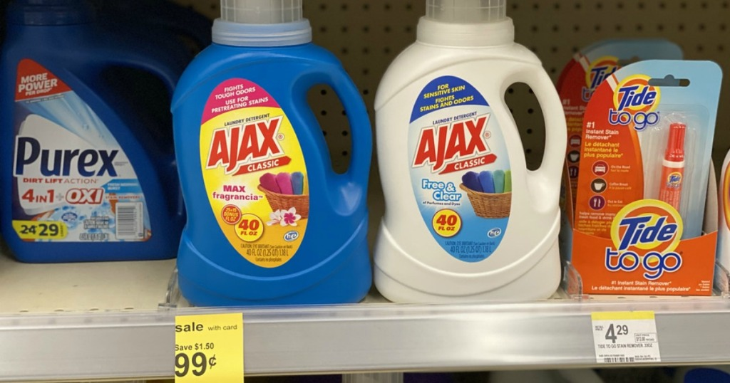 bottles of laundry detergent on a store shelf