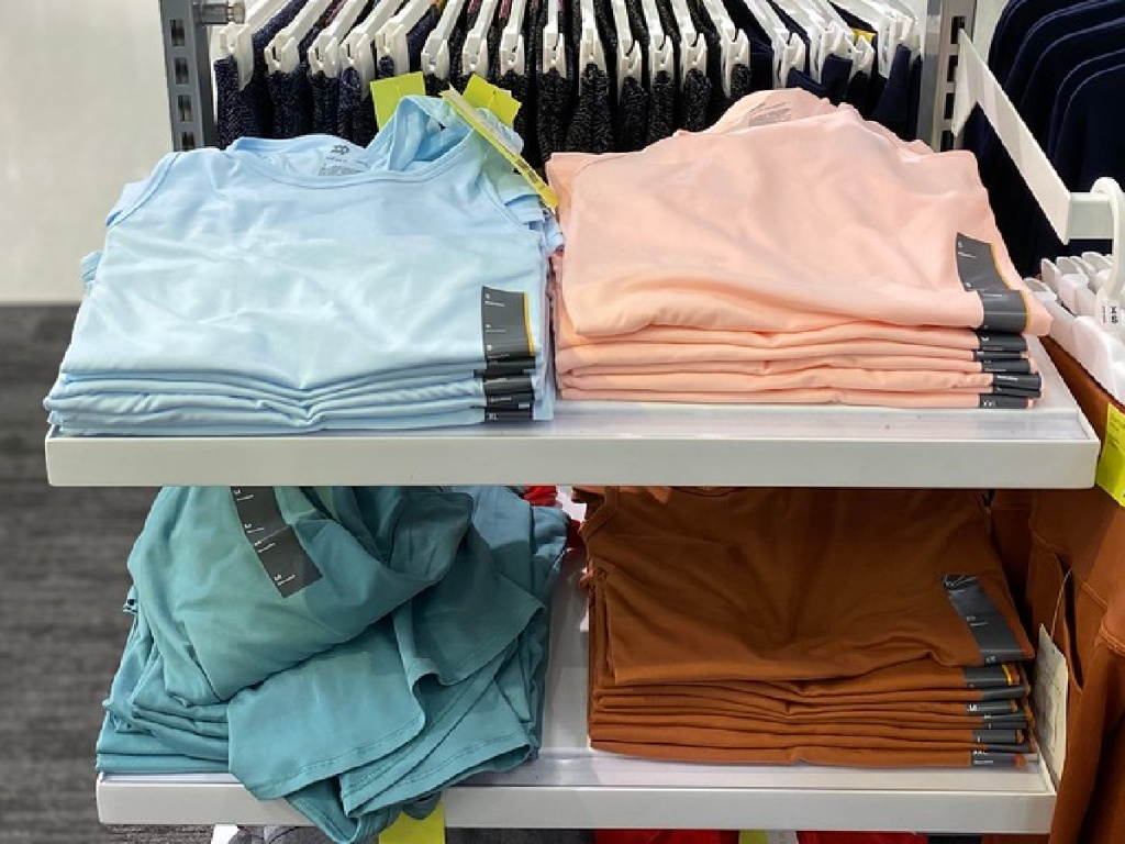 store with t-shirts folded and stacked up for display