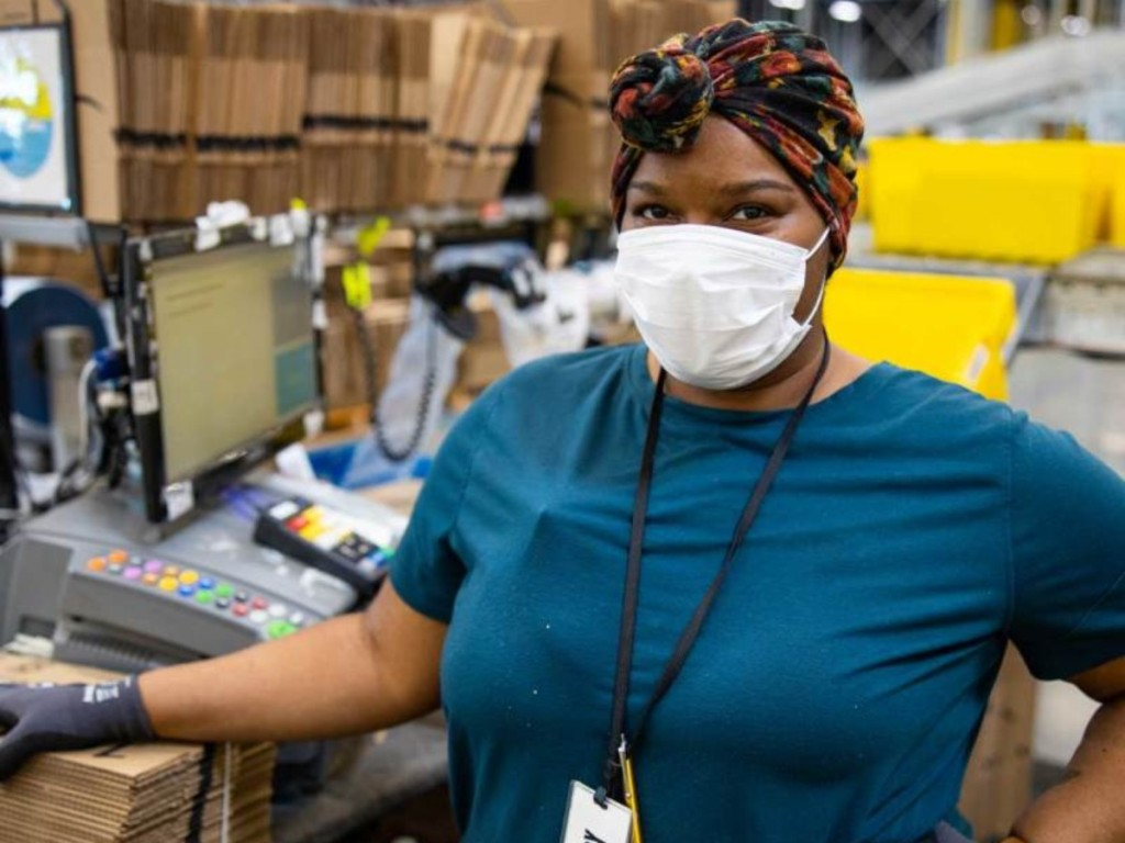 woman wearing mask in Amazon warehouse