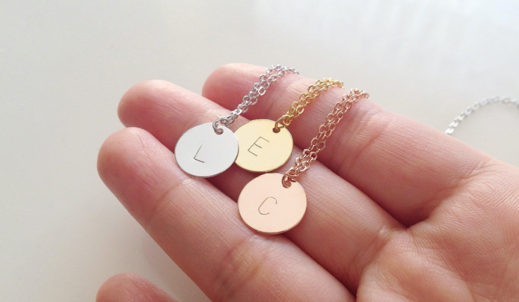 hand holding three circle initial necklaces - ways amazon prime day different last year