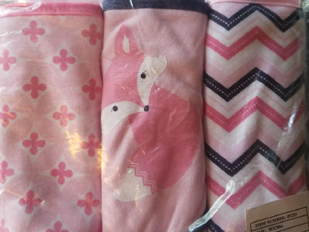 3 pink towels with a fox and stripes on them