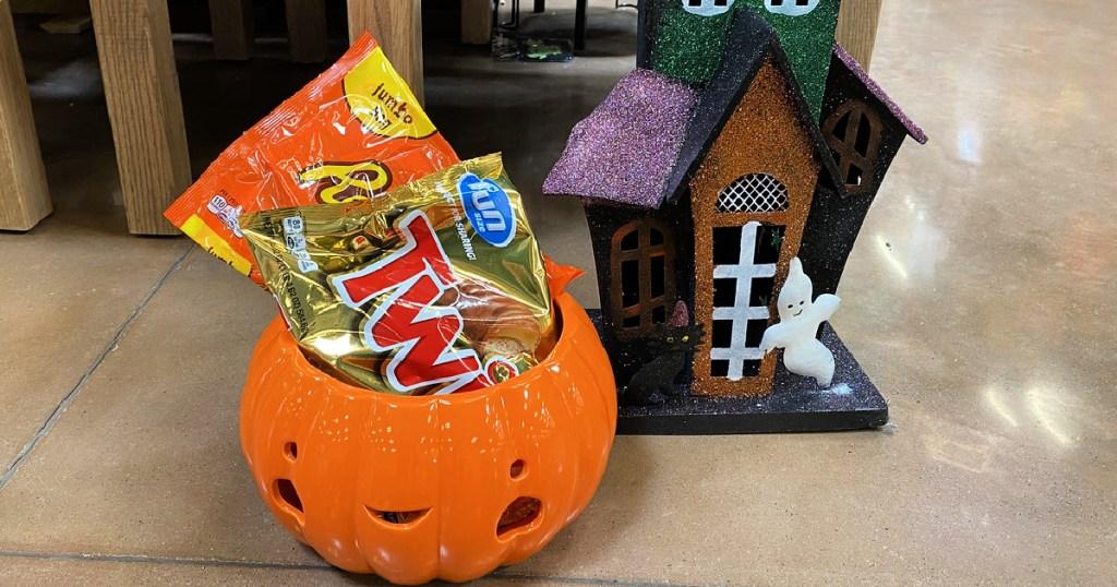 bagged candy in a glass pumpkin