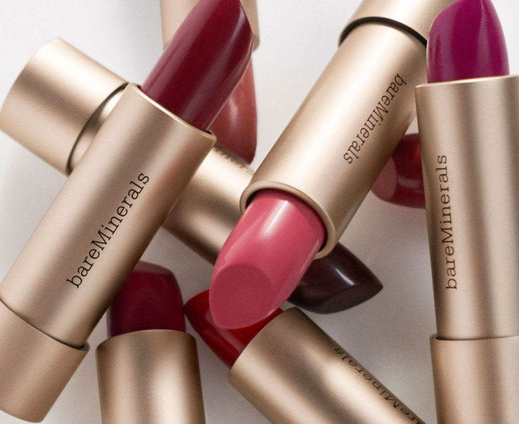 bareMinerals lipsticks in gold tubes in a pile on each other