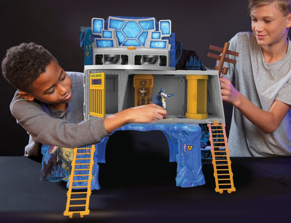 two boys playing with bat cave playset