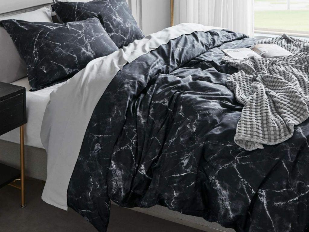 black marble duvet on bed in bedroom