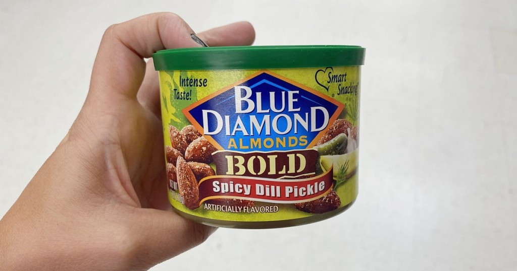 holding can of spicy dill pickle almonds
