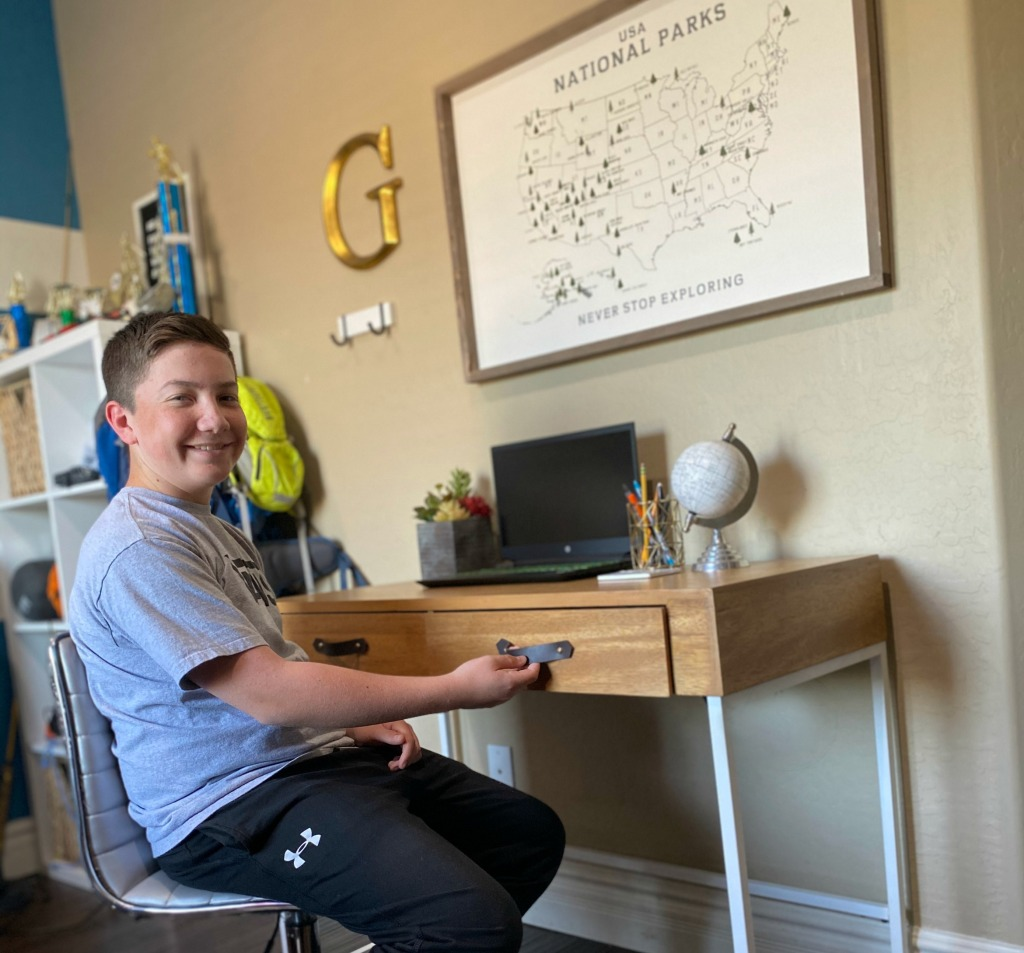 boy at desk with leather drawer pulls