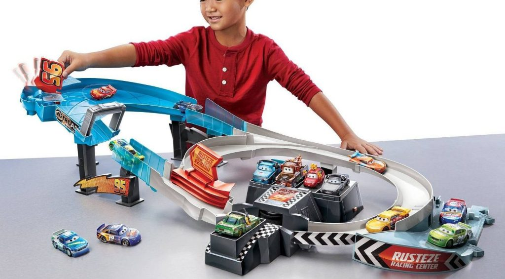 boy playing with cars rusteze trackset