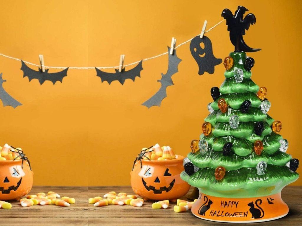 ceramic Halloween Tree with bat and pumpkin decorations around it