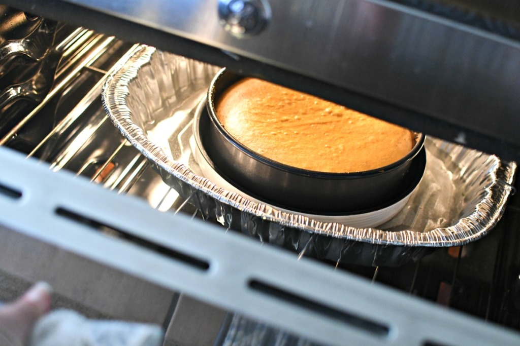 cheesecake cooling in the oven after cooking