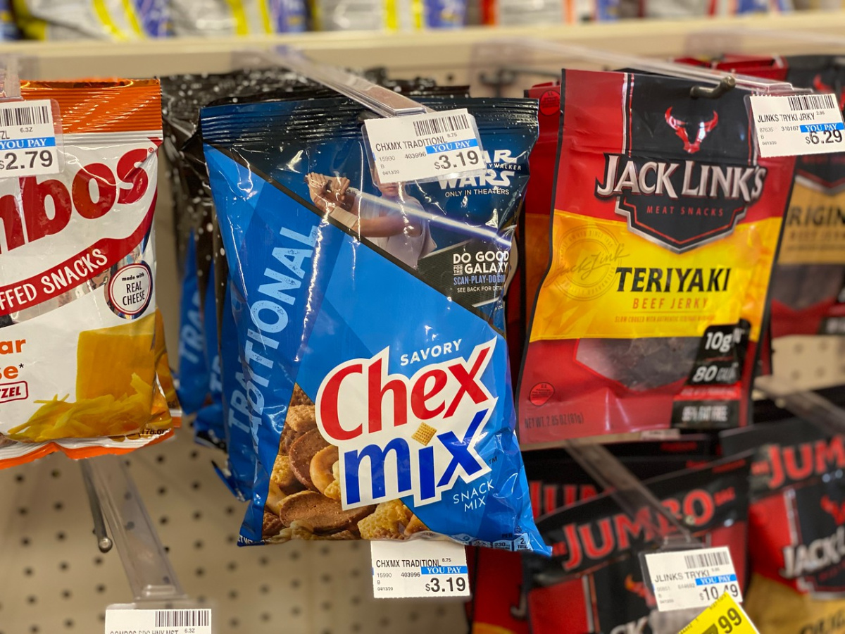 store display with bags of snacks hanging