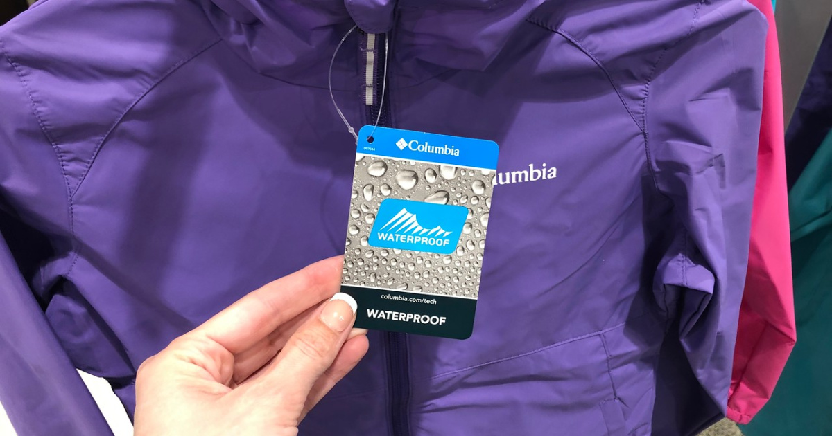 hand holding tag for a purple rain jacket