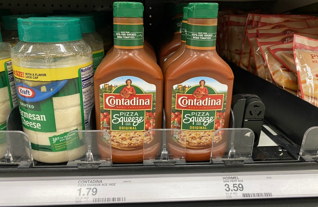 bottles of pizza sauce and a jar of parmesan cheese on a store shelf