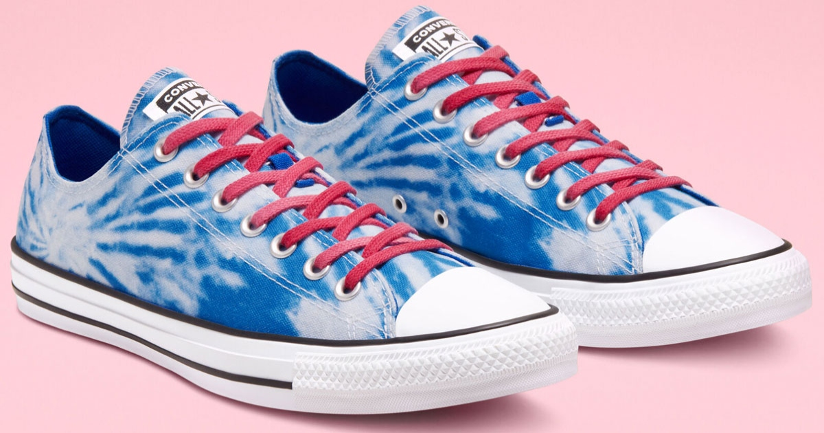 a pair of converse chuck Taylors, they are blue tie dye