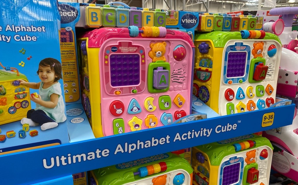 colorful cube activity toys for toddlers on store shelf in boxes