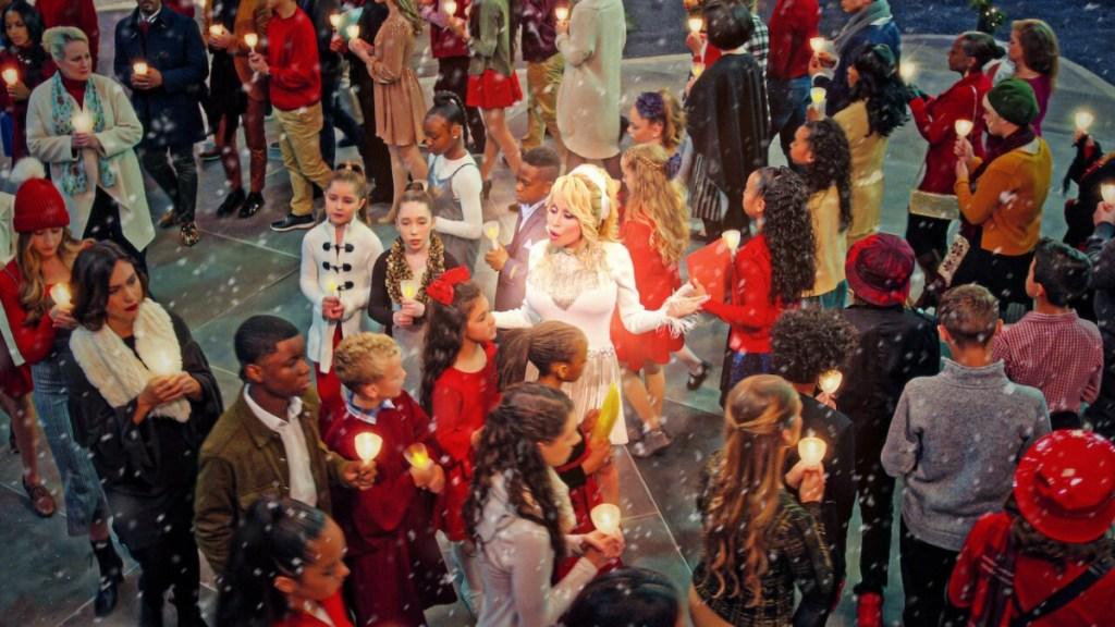 Dolly Parton singing among children
