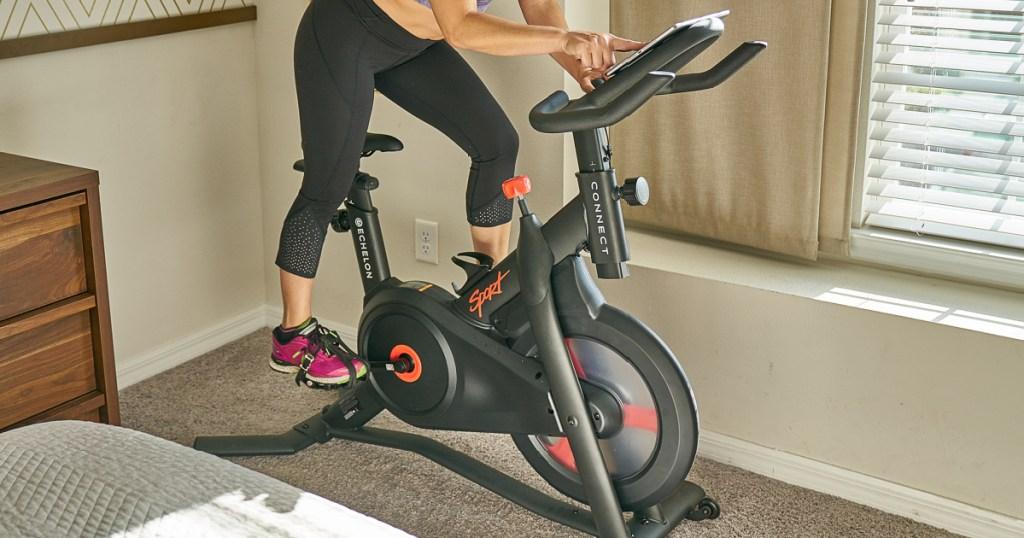 woman riding echelon cycyling bike