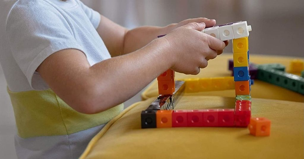 boy playing with colorful blocks