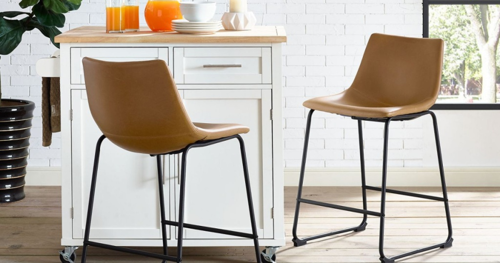 two faux leather barstools