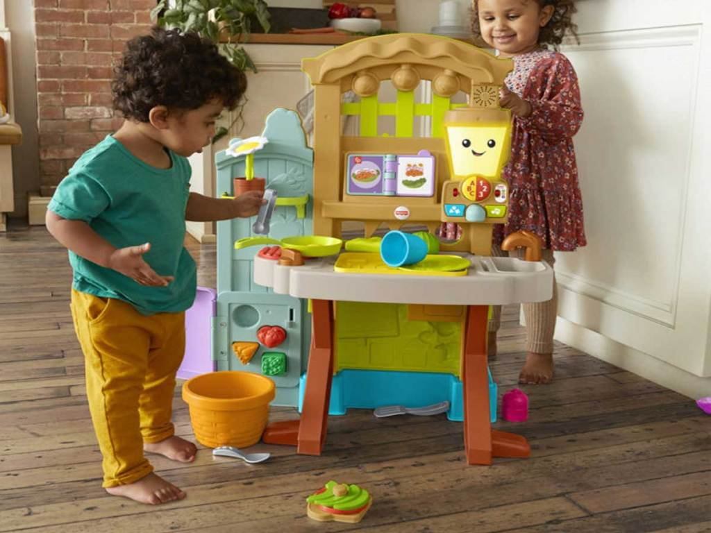 kids playing with a garden and kitchen playset