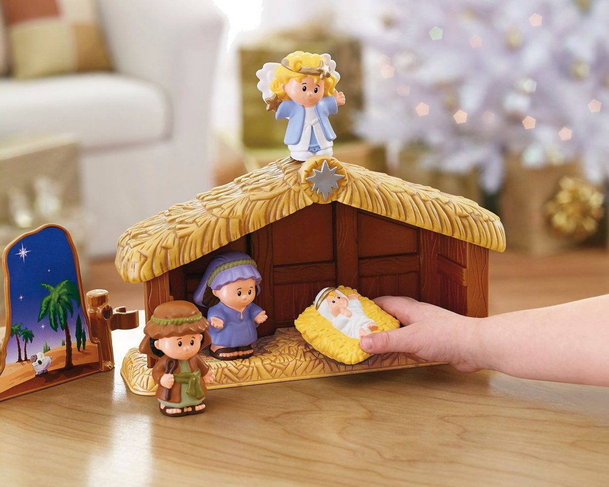 kid playing with fisher price nativity