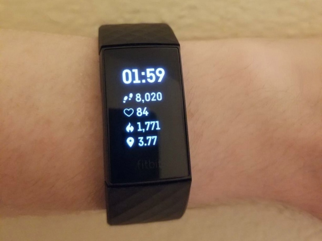 wrist wearing FitBit charge