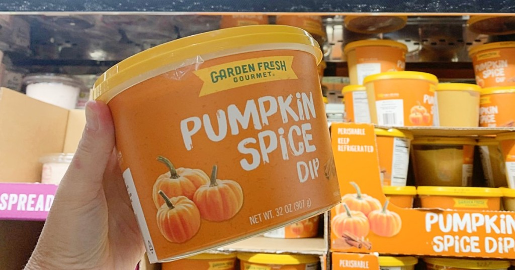 holding pumpkin spice dip at Costco