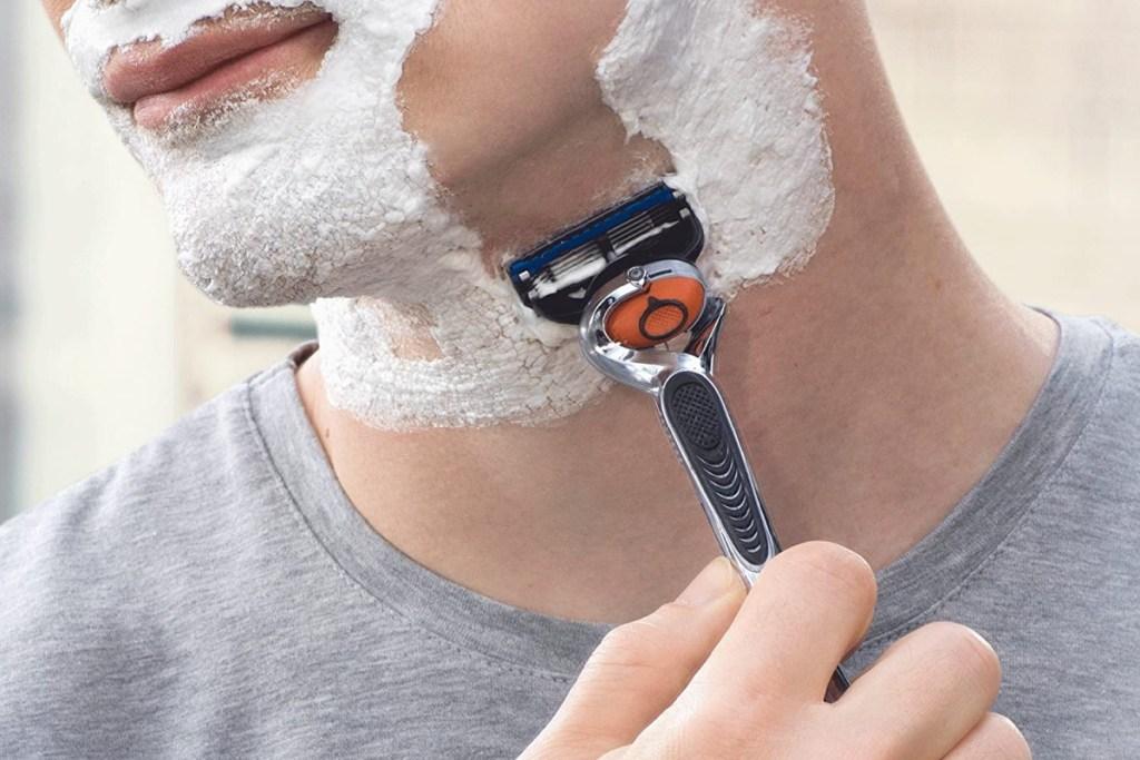 man shaving face using gillette proglide razor