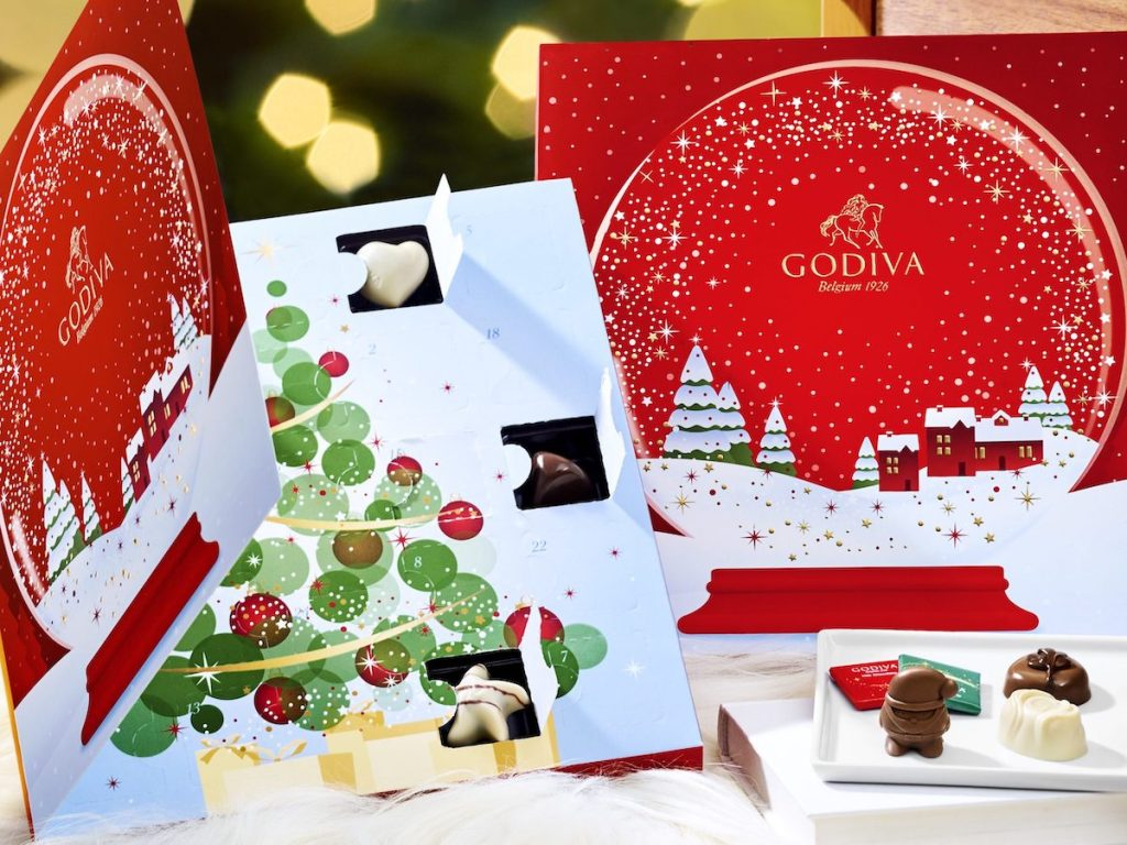 two godiva advent calendars with chocolate truffles on white plate