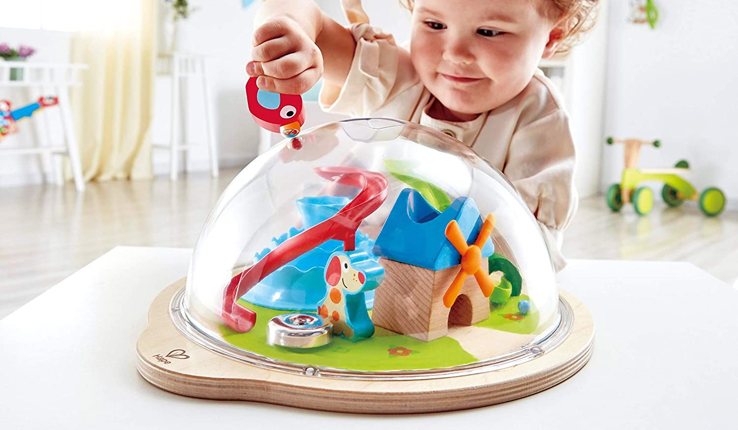 little boy using hape sunny dome magnetic game