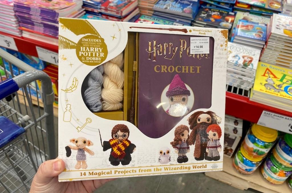 hand holding harry potter crochet set in store aisle