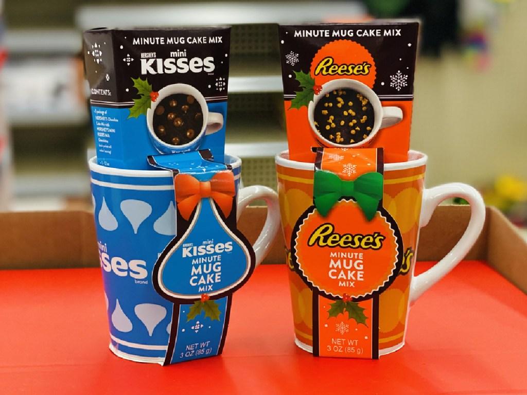 2 decorative mugs on store shelf with choclate