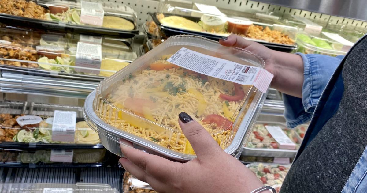 holding chicken enchilada bake Costco prepared meal