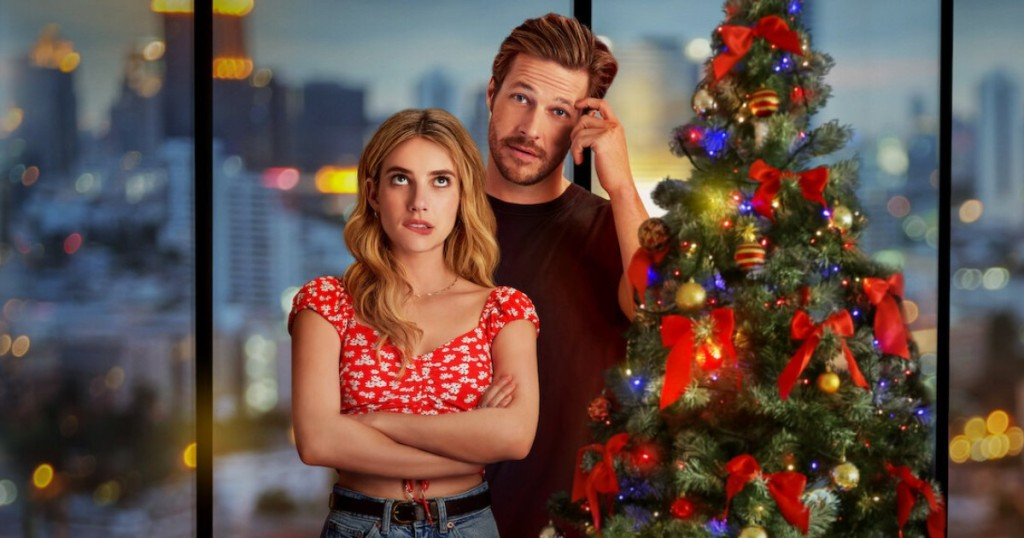 couple standing next to Christmas Tree