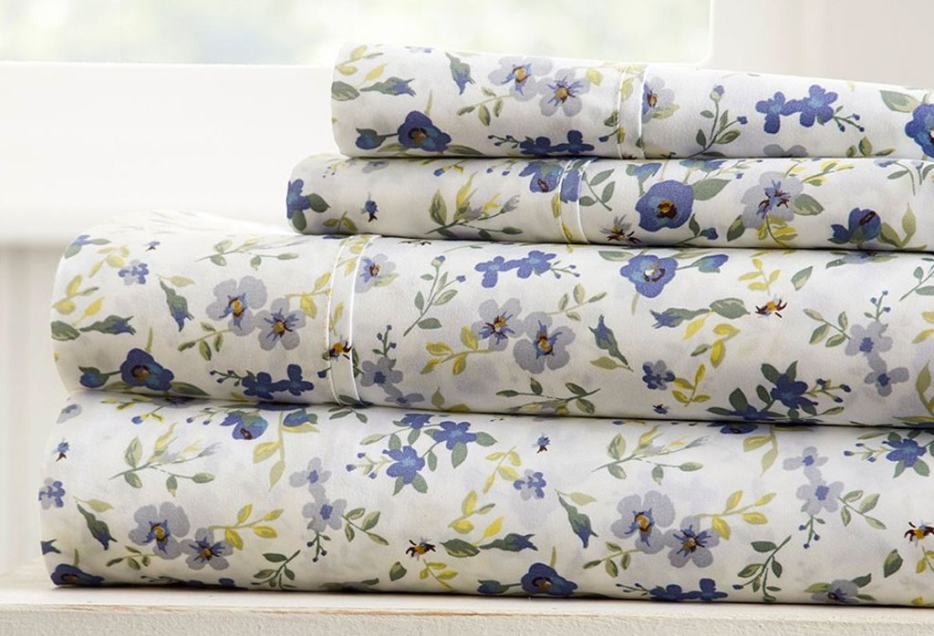 folded stack of sheets with blue floral print design