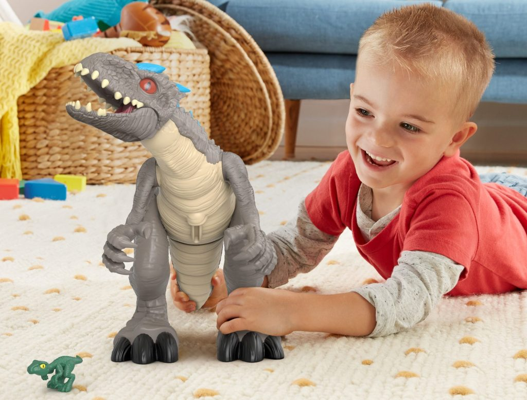 boy playing with indominus rex dino
