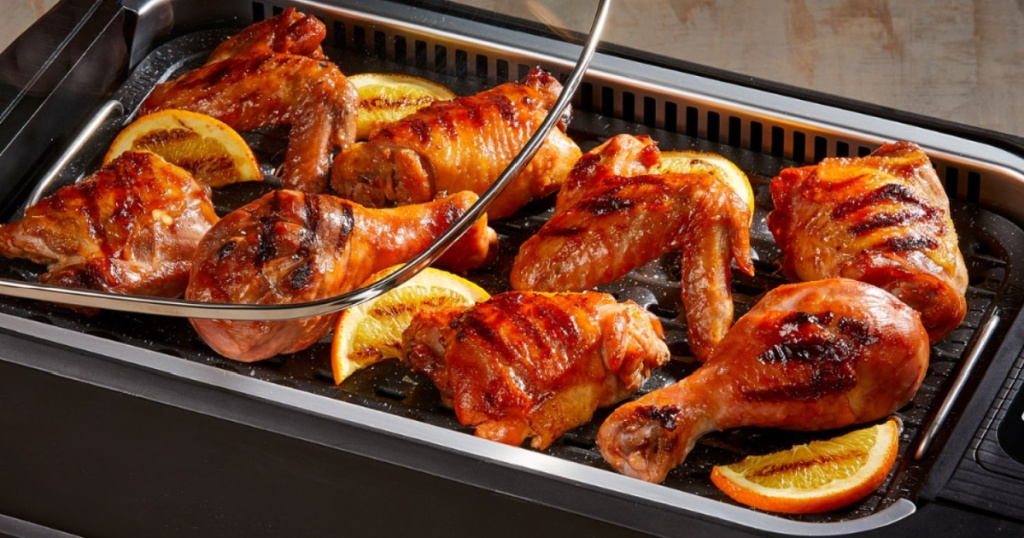 indoor grill with chicken cooking on it