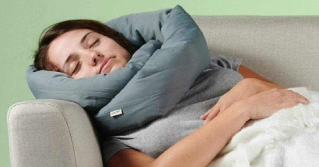 Woman wearing infinity Travel Pillow