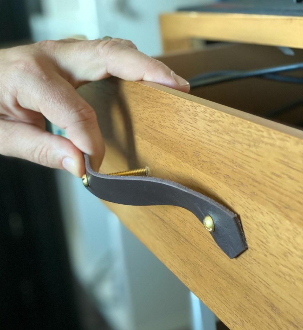 installing leather drawer pulls on a desk