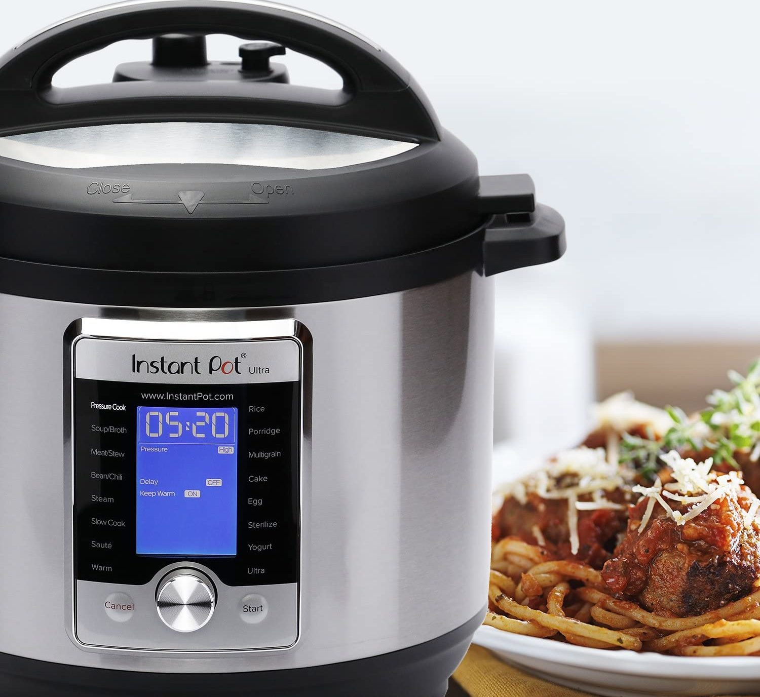instant pot ultra next to a plate of food