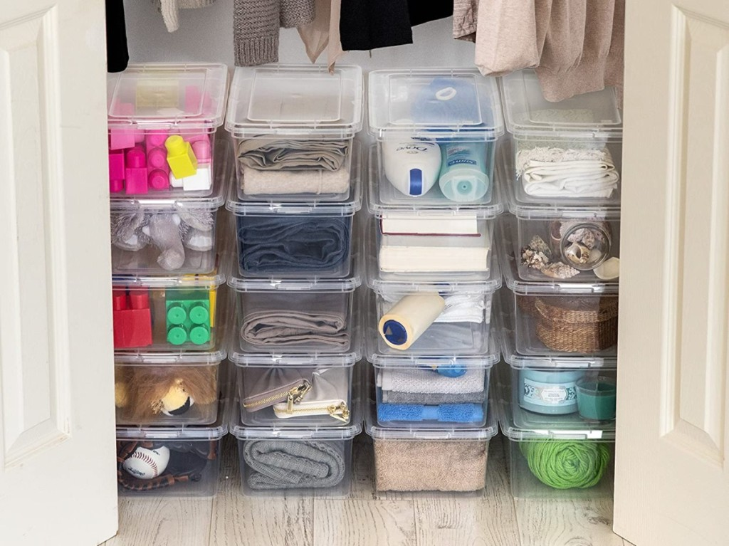 storage containers on floor of closet