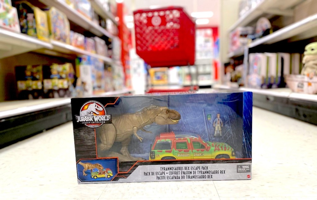 jurassic world toy on floor in store with target red cart in background