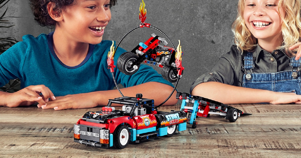 kids playing with a LEGO 2020 Technic Stunt Show Truck & Bike 610-Piece Building Kit
