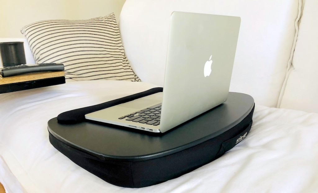 black lap desk with mac apple laptop on top