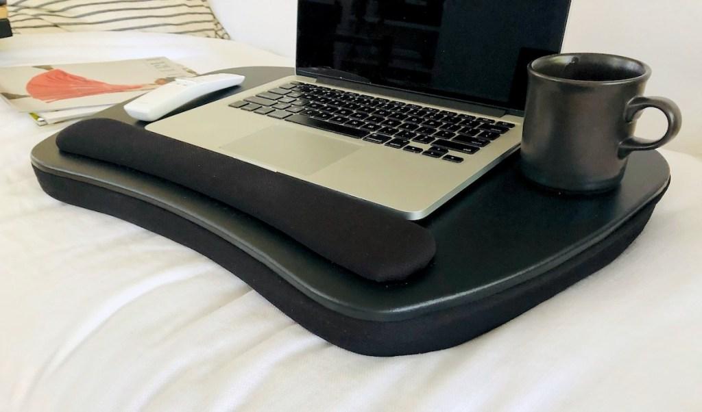 laptop sitting next to coffee mug