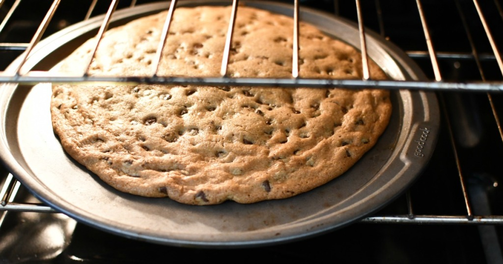 large cookie on a pizza pan cooking