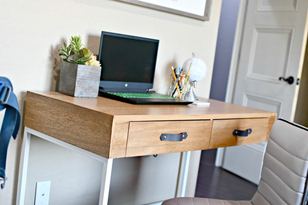 leather drawer pulls on a desk